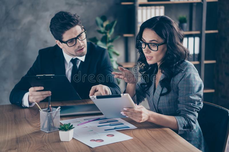 Photo of serious successful boss clarifying details of his worker report about investments having been attracted. Photo of serious successful, boss clarifying royalty free stock images