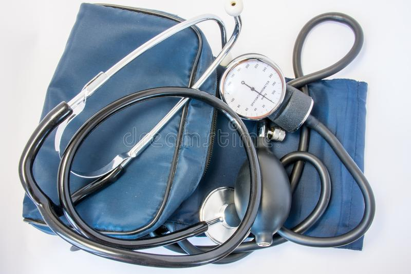 Photo set of stethoscope and arm sphygmomanometer with carrying bag or case. On white background is black stethoscope with sphygmo royalty free stock images