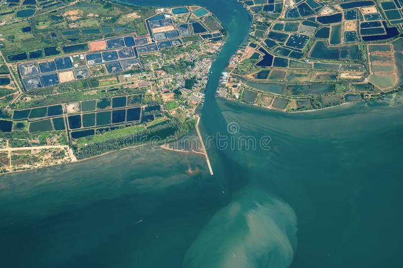 Photo shot from Jet Plane which shot the wide city beside the beach and sea in Middle of Thailand stock images