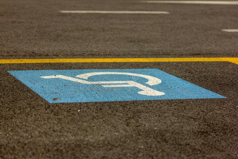 Photo showing the symbol of a disabled person placed on the parking lots intended for them. royalty free stock photo
