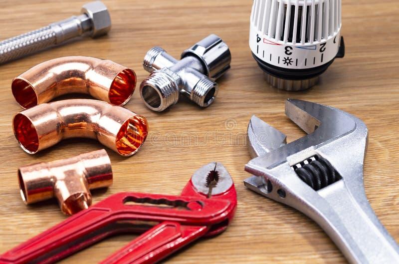 Plumbing tools on wodden table stock photography