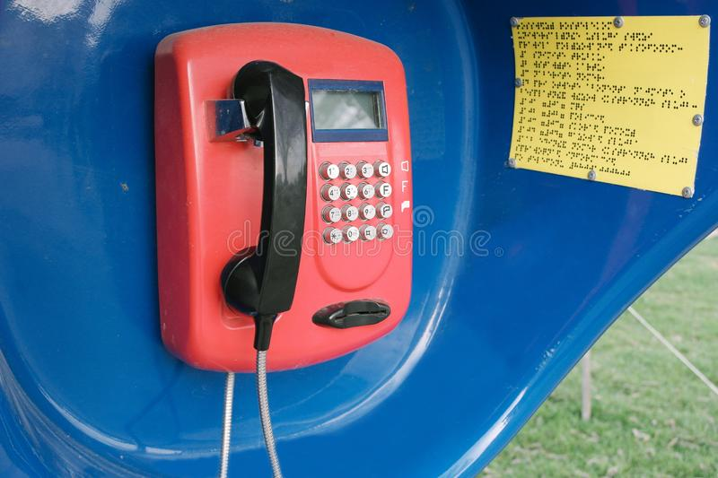 Red retro phone in the booth stock images