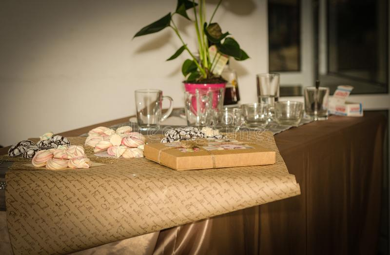 Beze, cookies, gingerbread and tea on the table. The photo shows a table. On it there is a kettle with tea and a cup. on the table there are goodies such as stock photo