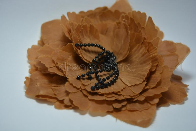 Brown flower with black stamens and petals made of cloth stock photo