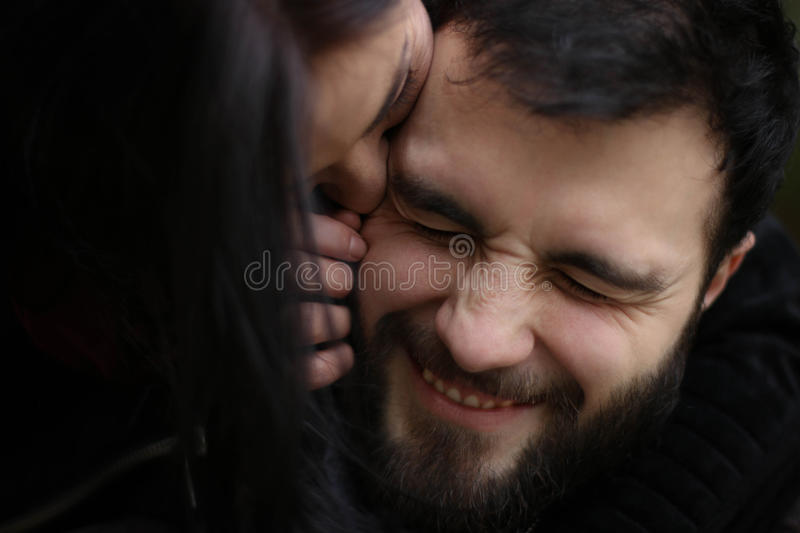 Silly couple. Photo of a silly couple in love, where the men is making a funny, yet happy face stock image