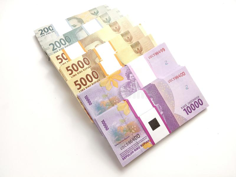 Close Up, Photo Simple Photo, Top View, Packs of Rupiah Indonesia Money, 2000, 5000, 10000, at white background stock image