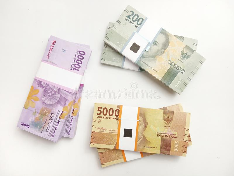 Flat Lay, Photo Simple Photo, Top View, Packs of Rupiah Indonesia Money, 2000, 5000, 10000, at white background royalty free stock photo