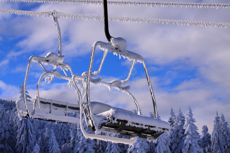 A photo of a ski lift. Empty ski lifts against pure blue sky royalty free stock photography