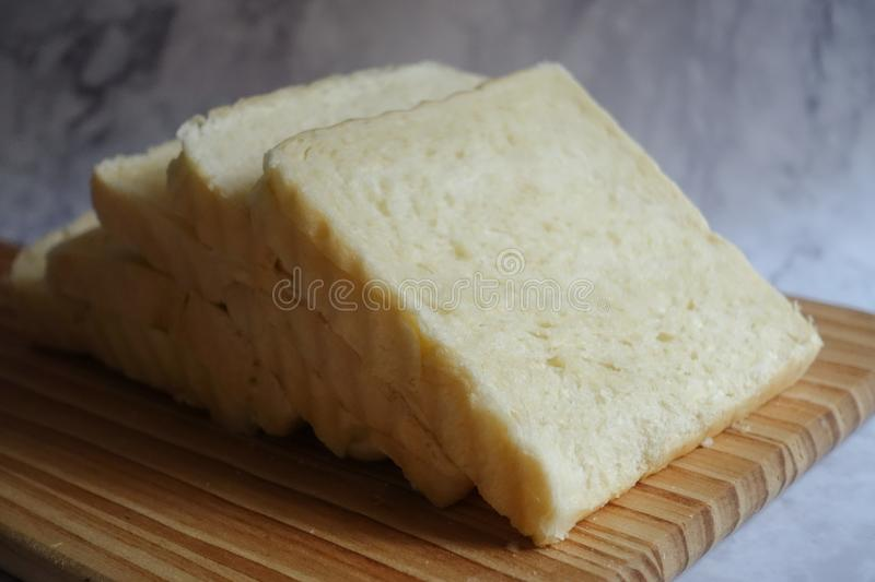 Photo of Sliced Bread on Brown Wooden Chopping Board royalty free stock photo