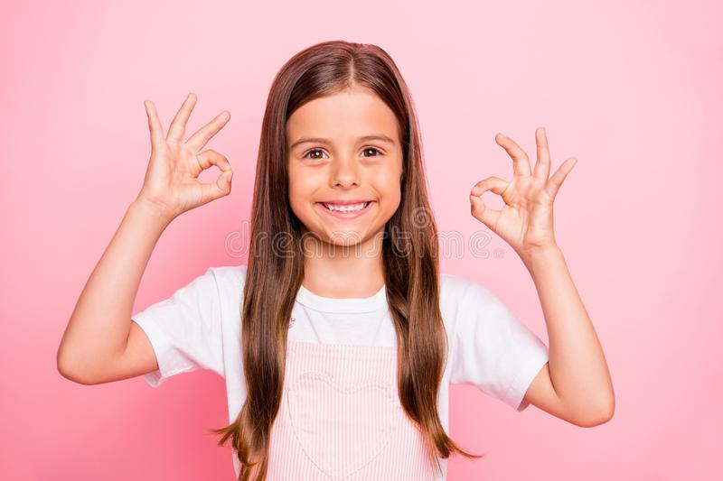 Photo of small lady brown hairstyle hands okey symbol friendly positive cheer mood wear overall t-shirt isolated pink stock photography
