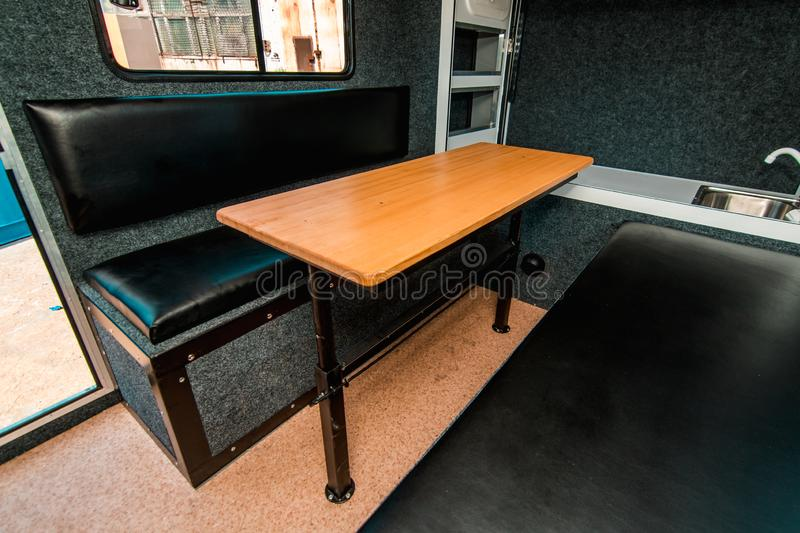 Photo of a small room with table, leather chairs. And window stock images