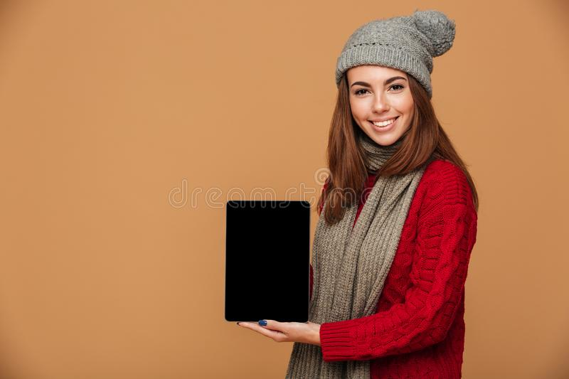 Smiling caucasian lady showing display of tablet computer. stock image