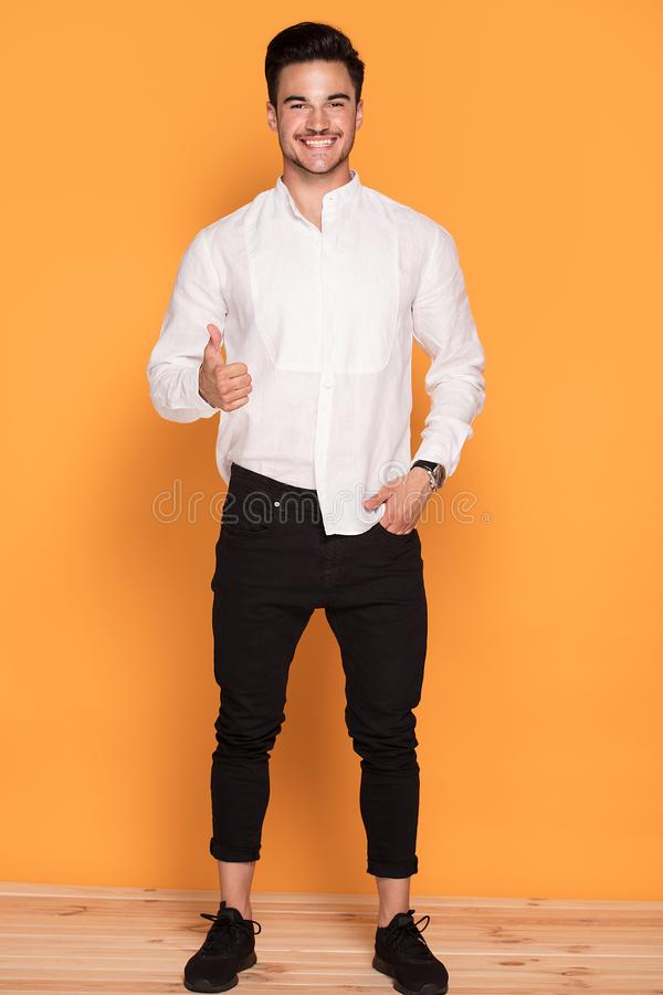 Handsome young man in elegant fashionable clothes stock image