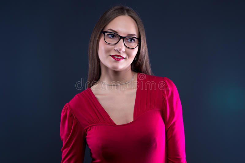 Photo of smiling woman in red shirt stock images