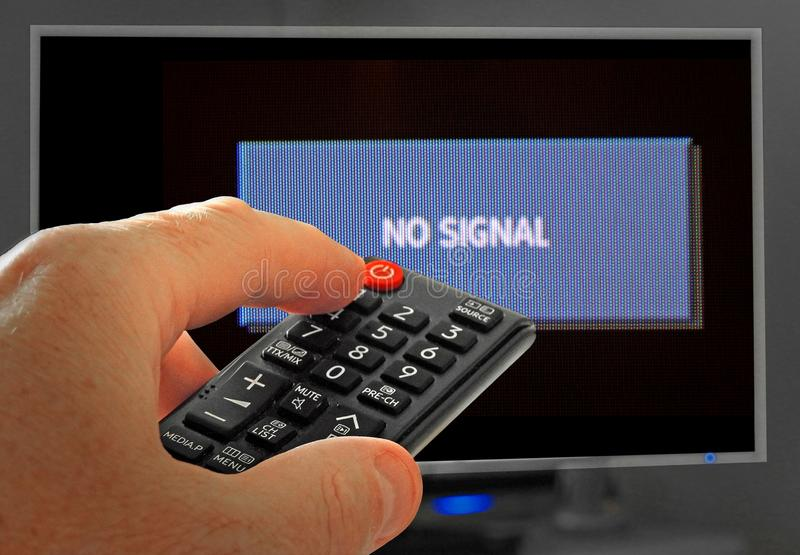No signal sign program tv channel television remote. Photo of someone using a remote control device to watch a tv program with no signal sign etc stock photography