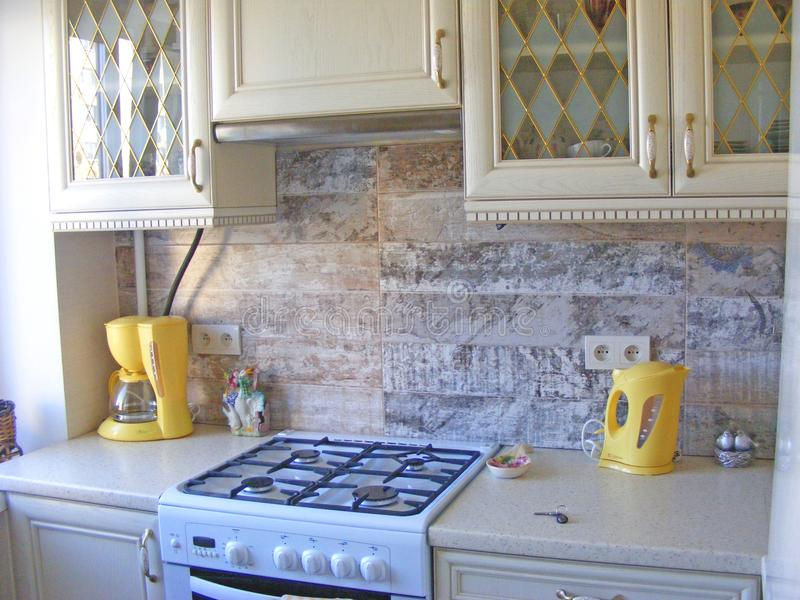 Photo of spacious wooden kitchen interior neat furnished ivory, royalty free stock photos