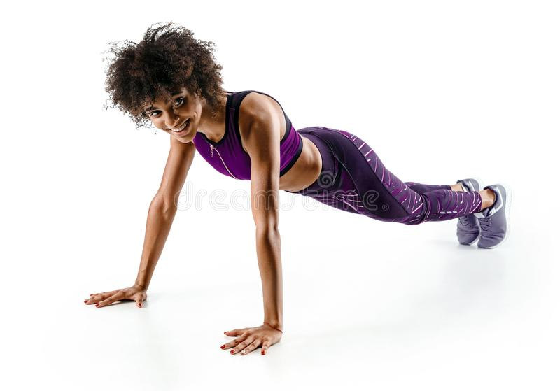 Photo of sporty african girl doing exercising royalty free stock photo