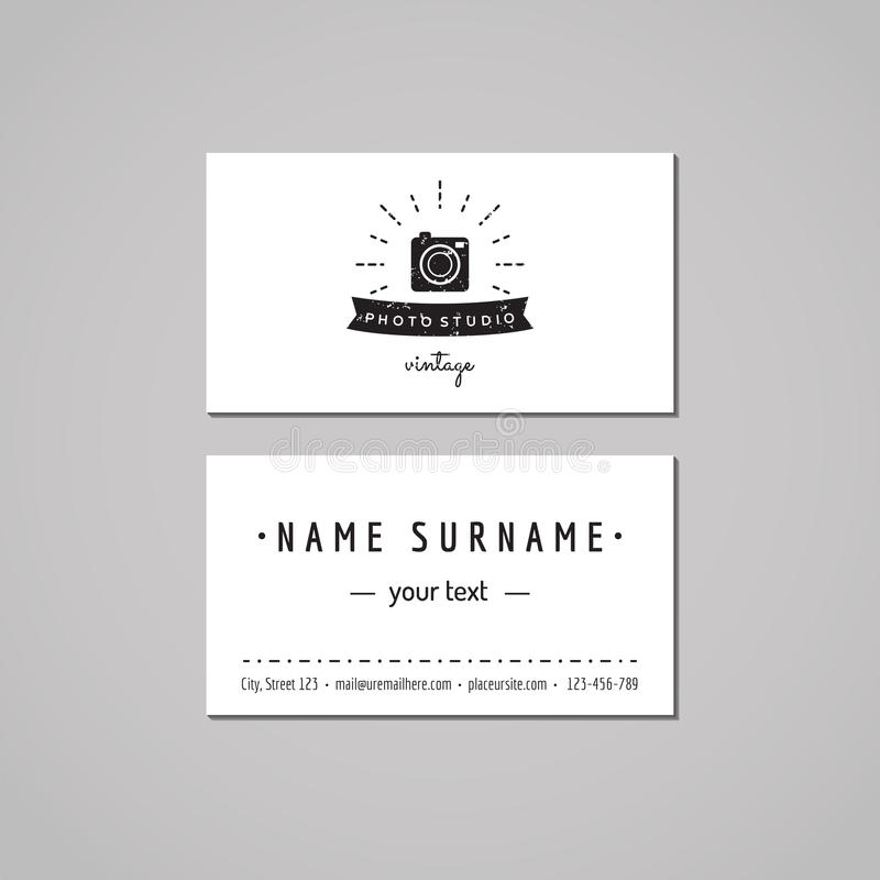 Photo studio business card design concept. Photo studio logo with photo camera, rays and ribbon. Vintage, hipster and retro style. Black and white royalty free illustration