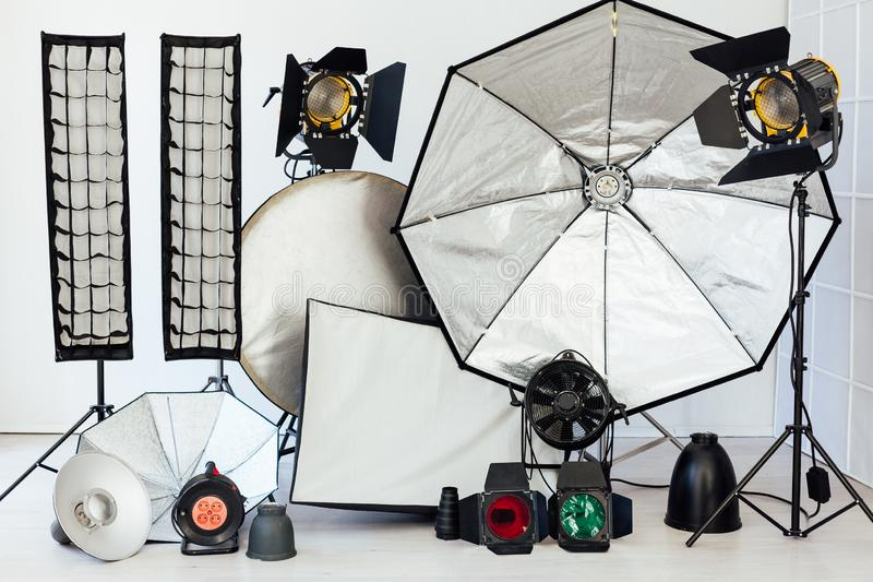 Photo studio equipment flash light accessories photographer on white background royalty free stock images
