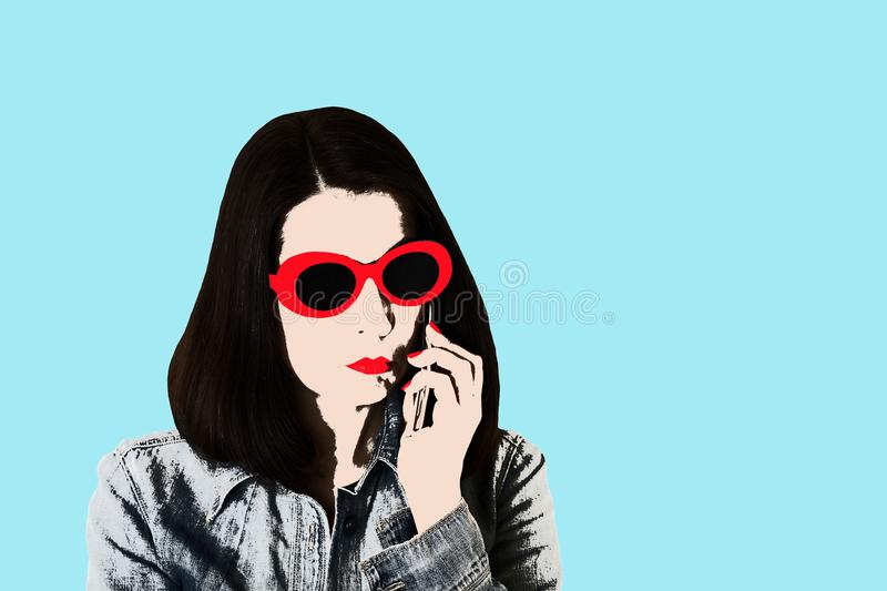 Photo in the style of pop art. Woman in denim shirt and sunglasses talking on a smartphone, pin up style. Young comic woman in retro style royalty free illustration