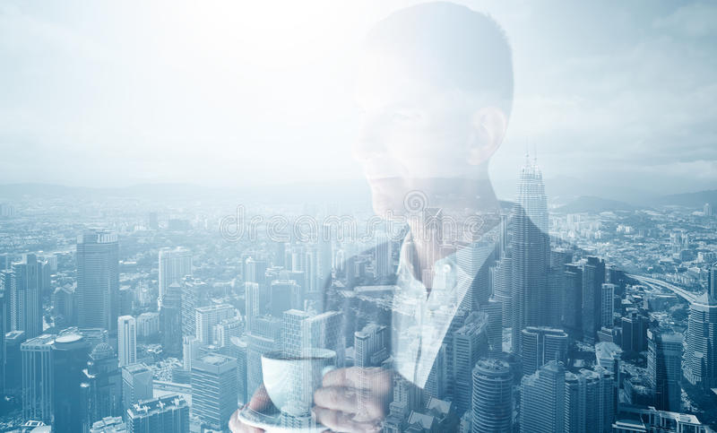 Photo of stylish adult businessman wearing trendy suit and holding cup coffee. Double exposure, panoramic view contemporary city. royalty free stock photography