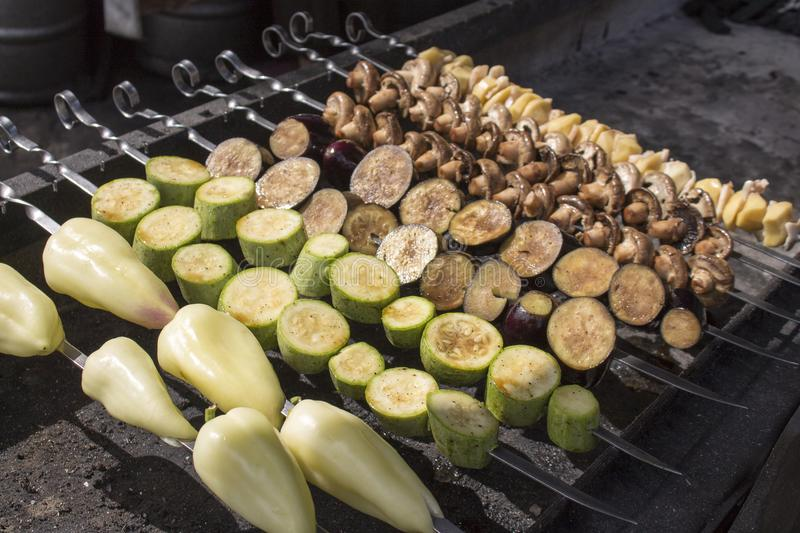 Photo of Summer grilling food. Raw vegetables on skewers royalty free stock photos