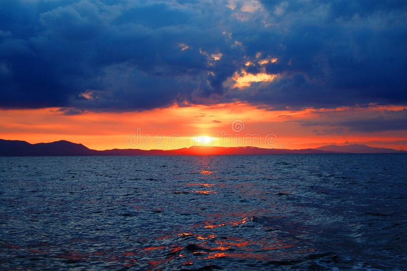 Photo of Sunset over Large Body of Water royalty free stock photography
