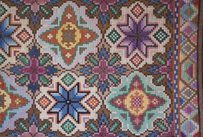 Photo surface beautiful carpet handmade. Embroidery Bulgarian cross royalty free stock photography