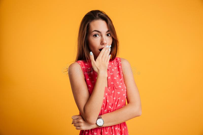 Photo of surprised pretty girl in red dress standing with her ha royalty free stock photo