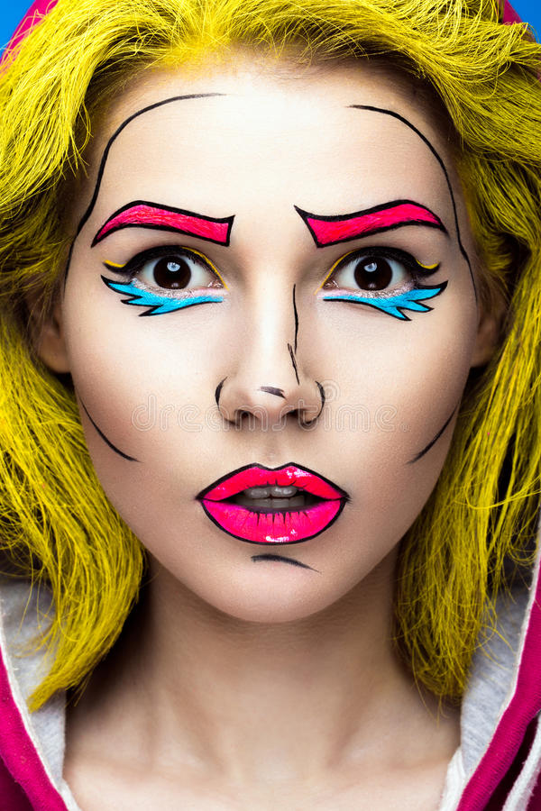 Photo of surprised young woman with professional comic pop art make-up. Creative beauty style. stock photography
