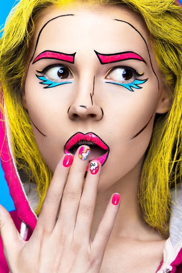 Photo of surprised young woman with professional comic pop art make-up and design manicure. Creative beauty style. royalty free stock photos