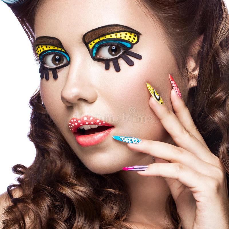Photo of surprised young woman with professional comic pop art make-up and design manicure. Creative beauty style. stock photos