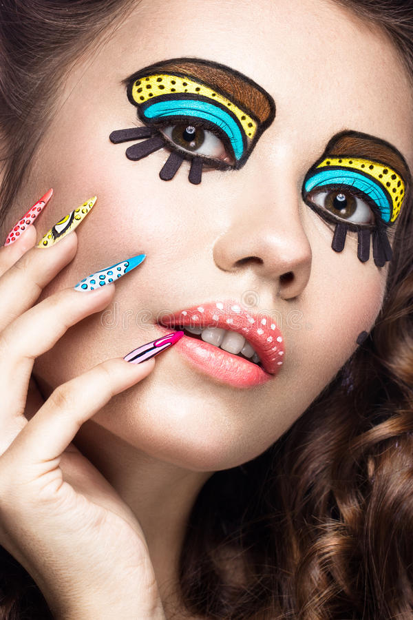 Photo of surprised young woman with professional comic pop art make-up and design manicure. Creative beauty style. stock photo