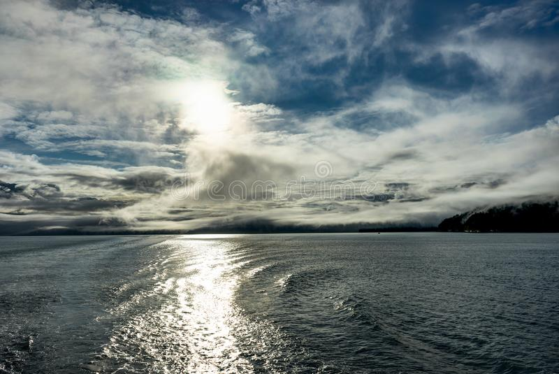Mountains covered in clouds on a misty morning on the Ferry towa. Photo taken in Alaska, United States of America stock photo