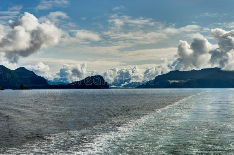 Mountains covered in clouds on a misty morning on the Ferry towa. Photo taken in Alaska, United States of America royalty free stock photo