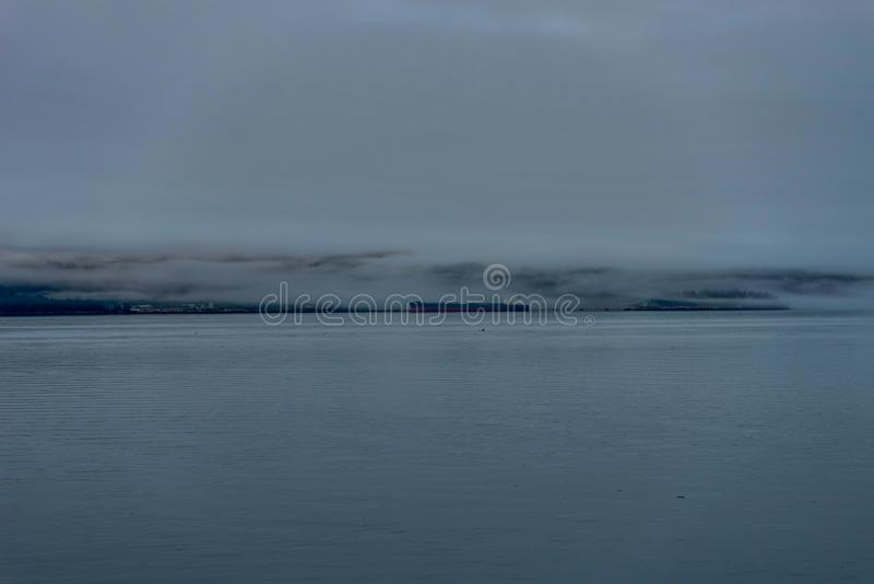 Whittier covered in fog in Alaska United States of America. Photo taken in Alaska, United States of America royalty free stock photo