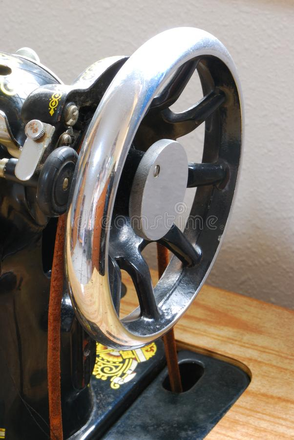 Nostalgic old black sewing machine pulley head section royalty free stock photos