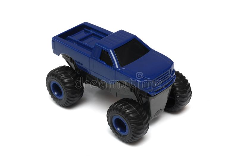 A blue monster truck toy car. A photo taken on a blue monster truck toy car against a white backdrop stock image