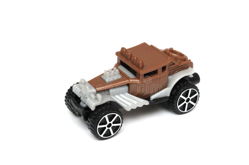 A Brown classic vintage old design toy car with modern open pipes and side exhaust pipes and a skull head at the front stock photos