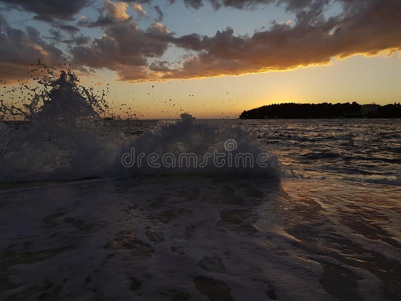 Wave splash in the evening at Rovinj Croatia royalty free stock images