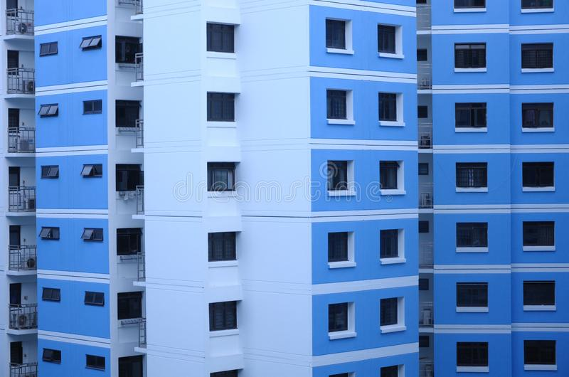 An external face of an apartment block. A photo taken on the external face of a blue painted apartment block royalty free stock images