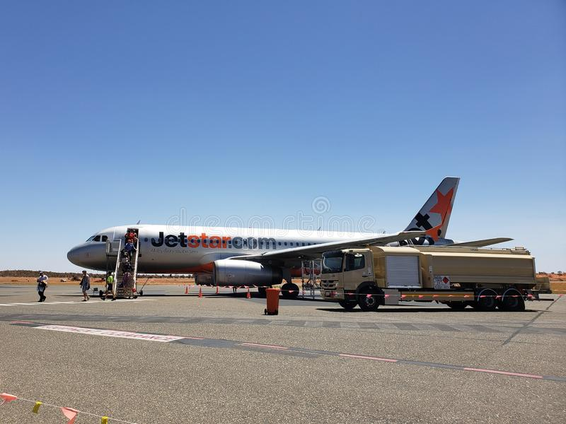 A Jetstar aircraft landed on Ayers Rock Airport in Australia. Photo is taken on 28 Feb 2019, at Ayers Rock Airport in the Northern Territory of Australia. The stock photography