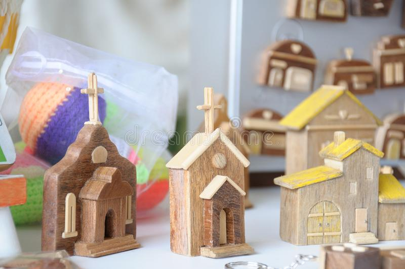A few miniature display of churches entrances and houses made of carved wood. A photo taken on a few miniature display of handmade churches entrances and houses stock photo