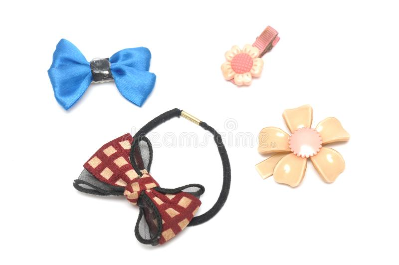 A hair band and some hair clips of flowery and ribbon designs royalty free stock photo