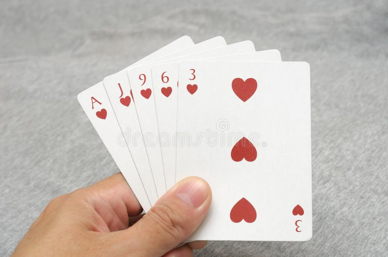 Flush poker hands. A photo taken on a hand holding five cards in a poker game showing the poker hands of Flush royalty free stock photos