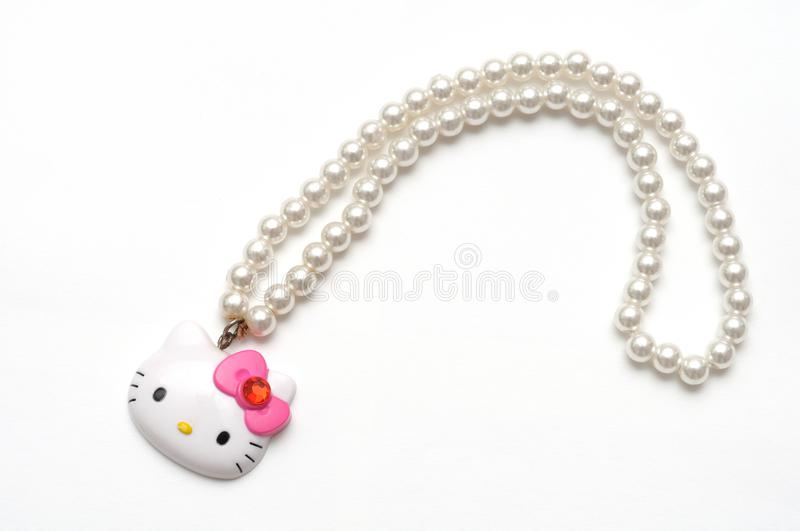 A Hello Kitty plastic toy pearl necklace royalty free stock photography