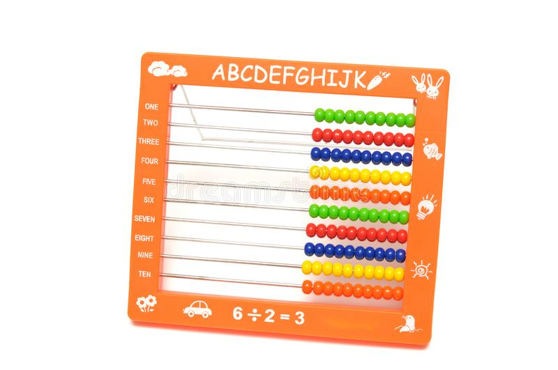An orange colored abacus with colorful beads royalty free stock image