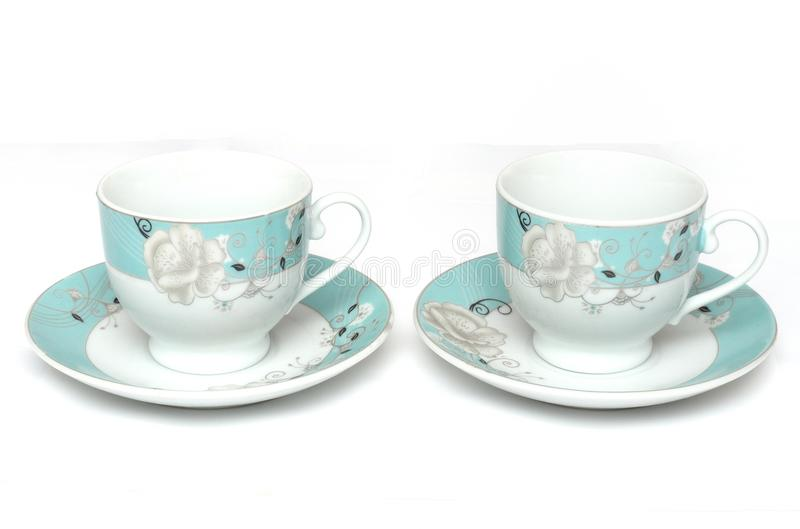 A pair of light colored teacups with saucers royalty free stock photos