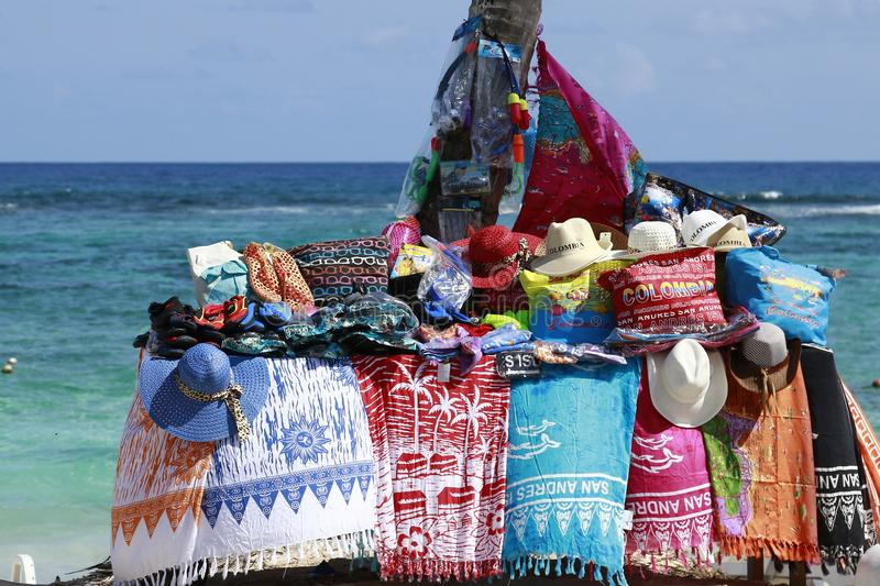 Colombian Souvenirs at he beach. Photo taken at San Andres beach on a beautiful sunny day. Some of the souvenirs tourists can buy on a regular basis royalty free stock images