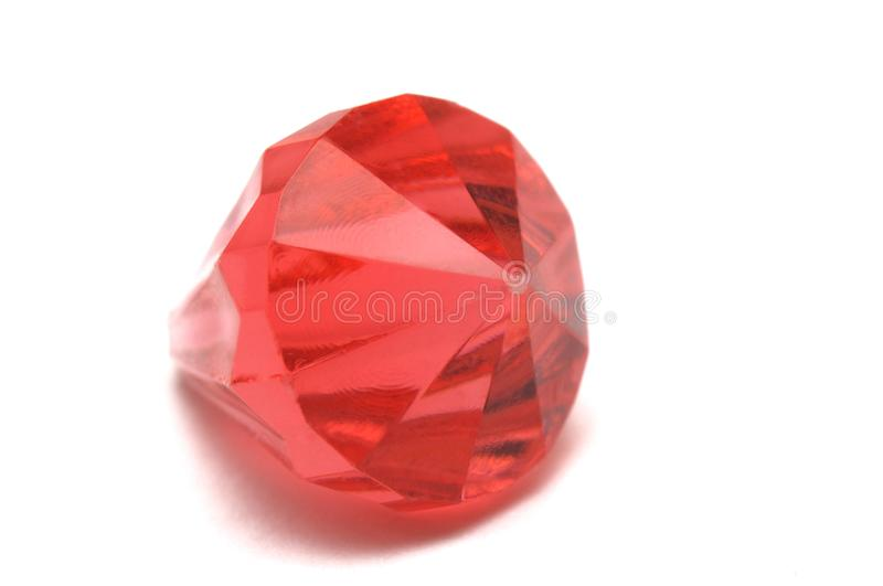 A single ruby red colored fake diamond royalty free stock photos